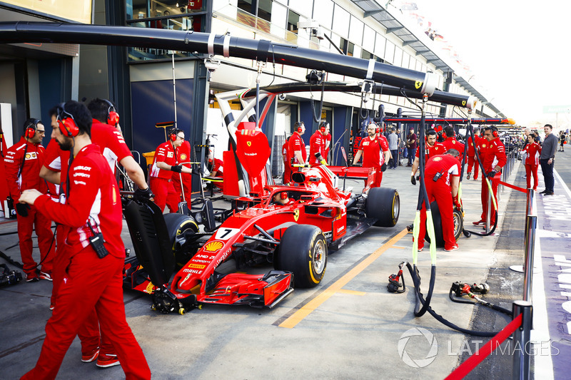 The Ferrari team practice their pit stops