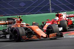 Sebastian Vettel, Ferrari SF70H and Stoffel Vandoorne, McLaren MCL32 battle