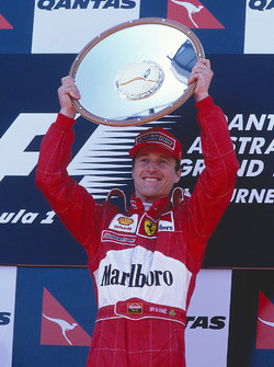 Podium: winner Eddie Irvine, Ferrari celebrates