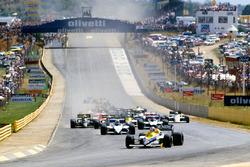 Start: Nigel Mansell, Williams FW10 leads Nelson Piquet, Brabham BT54 and Marc Surer, Brabham BT54