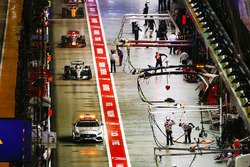 The Safety Car leads Lewis Hamilton, Mercedes AMG F1 W08, the rest of the field through the pit lane