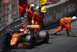 Marshals clear the wreckage after Stoffel Vandoorne, McLaren MCL32, crashes