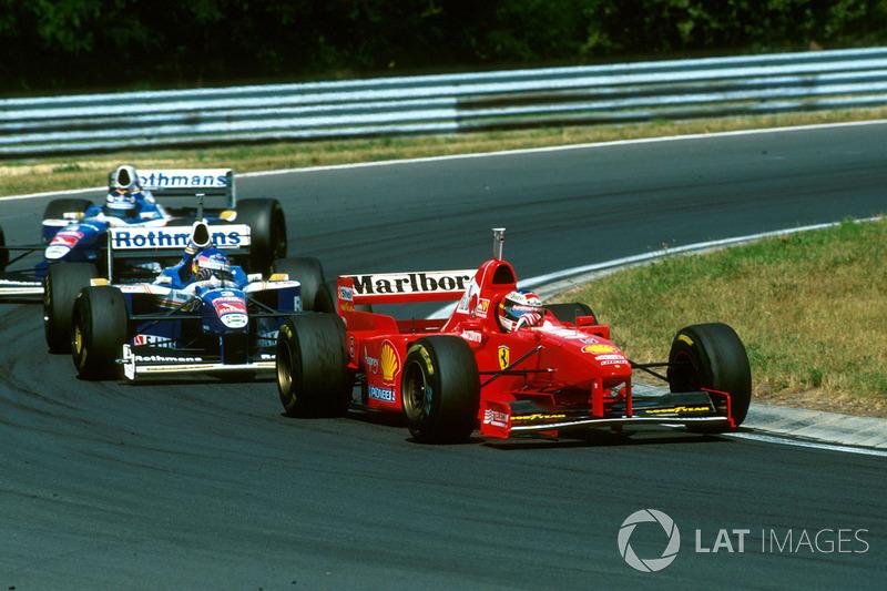 Міхаель Шумахер (Ferrari F310B), Жак Вільньов і Хайн-Харальд Френтцен (Williams FW19 Renault)