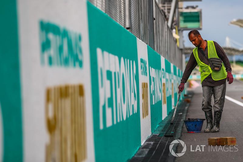 Track worker paints Petronas branding