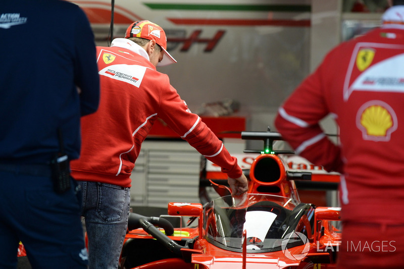 Sebastian Vettel, Ferrari looks at Ferrari SF70-H with cockpit shield
