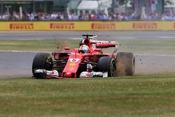 Sebastian Vettel, Ferrari SF70H, with a front puncture