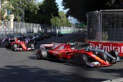 Kimi Raikkonen, Ferrari SF70H battles, Valtteri Bottas, Mercedes AMG F1 F1 W08  for position and collide at the start of the race