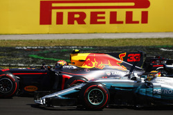 Max Verstappen, Red Bull Racing RB13, passes Lewis Hamilton, Mercedes AMG F1 W08