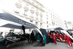 The Mercedes AMG F1 and Ferrari teams prepare for the London F1 street demonstration