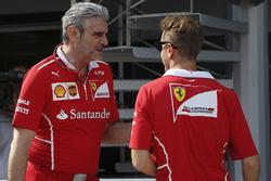 Maurizio Arrivabene, Ferrari Team Principal and Sebastian Vettel, Ferrari