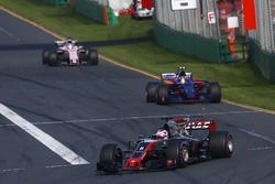 Romain Grosjean, Haas F1 Team VF-17, leads Carlos Sainz Jr., Scuderia Toro Rosso STR12, and Sergio Perez, Force India VJM10