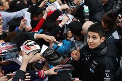 Esteban Ocon, Force India, signs autographs for fans