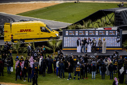 Winner David Coulthard is presented with his trophy on the podium