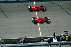 Rubens Barrichello, Ferrari F2002 past Michael Schumacher, Ferrari F2002