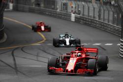 Sebastian Vettel, Ferrari SF71H, leads Lewis Hamilton, Mercedes AMG F1 W09 and Kimi Raikkonen, Ferrari SF71H
