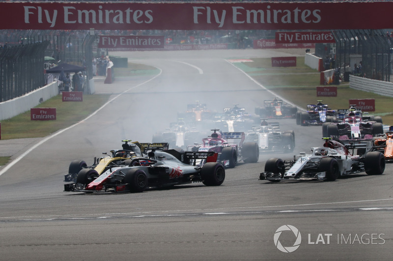 Romain Grosjean, Haas F1 Team VF-18, Carlos Sainz Jr., Renault Sport F1 Team R.S. 18 and Charles Leclerc, Sauber C37