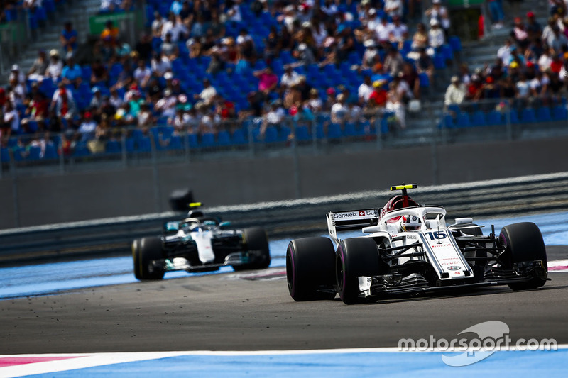 Charles Leclerc, Sauber C37, leads Valtteri Bottas, Mercedes AMG F1 W09