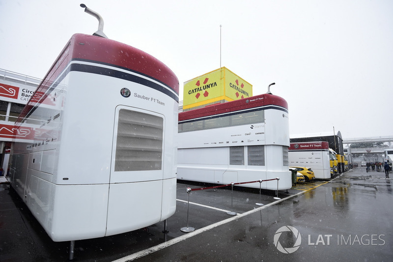 Alfa Romeo Sauber F1 Team trucks as snow stops testing on day three