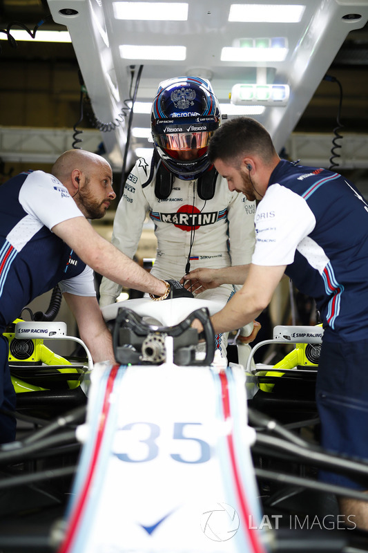 Sergey Sirotkin, Williams Racing, settles into his car