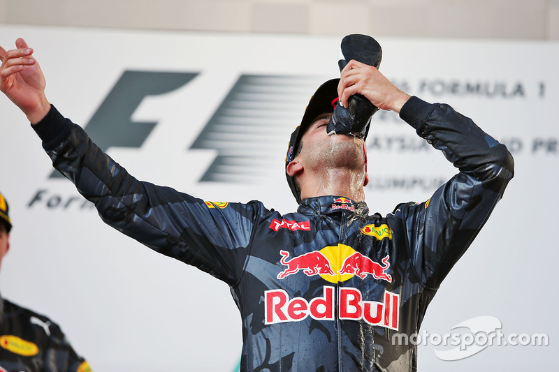 Race winner Daniel Ricciardo, Red Bull Racing celebrates on the podium by drinking champagne from his race boot