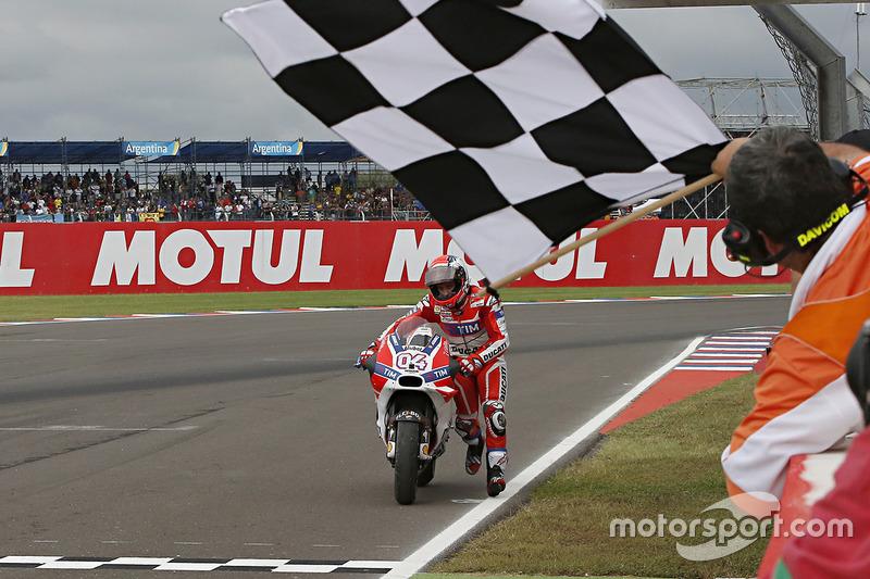 Andrea Dovizioso, Ducati Team pushes his bike across the line