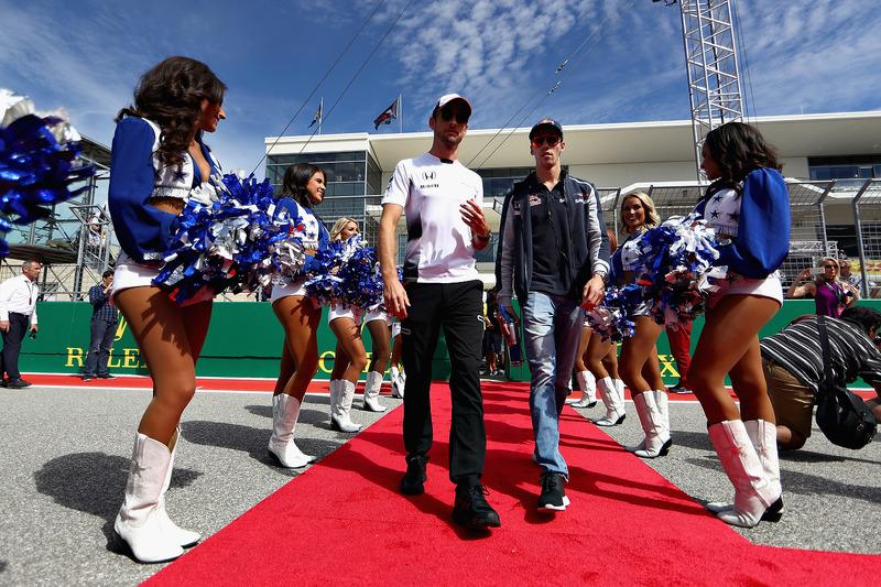 Jenson Button, McLaren; Daniil Kvyat, Scuderia Toro Rosso