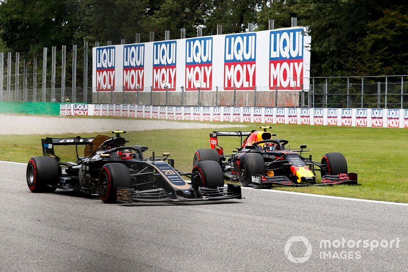 Kevin Magnussen, Haas VF-19 and Alex Albon, Red Bull Racing RB15 out of the track