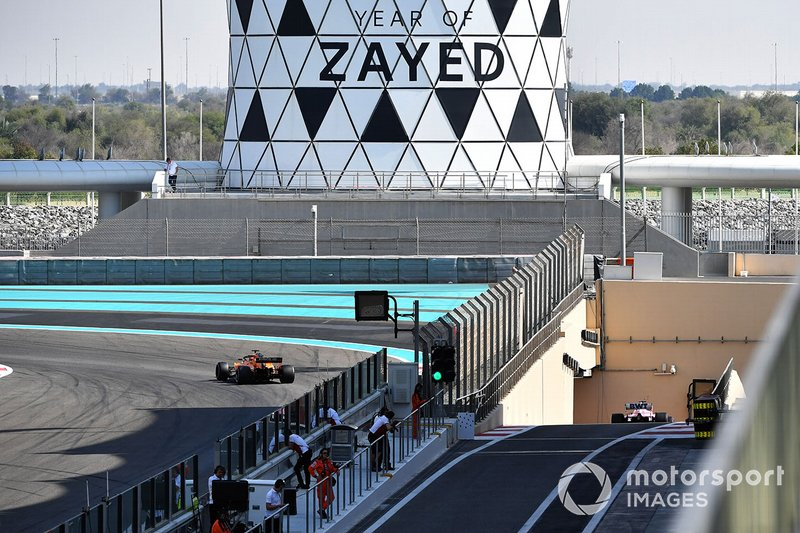 Carlos Sainz Jr., McLaren MCL33 and Lance Stroll, Racing Point Force India VJM11