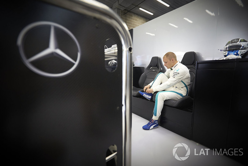 Valtteri Bottas, Mercedes AMG F1, adjusts his boot