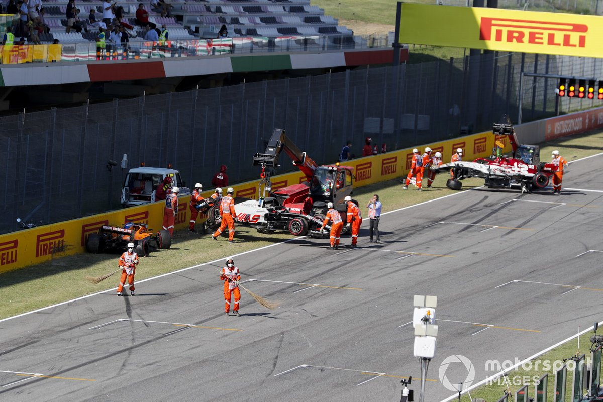 Cars of Carlos Sainz Jr., McLaren MCL35, Kevin Magnussen, Haas VF-20 and Antonio Giovinazzi, Alfa Romeo Racing C39 being recovered after crashing