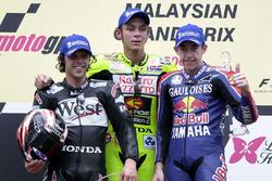 Podium: winner Valentino Rossi, second place Loris Capirossi, third place Garry McCoy