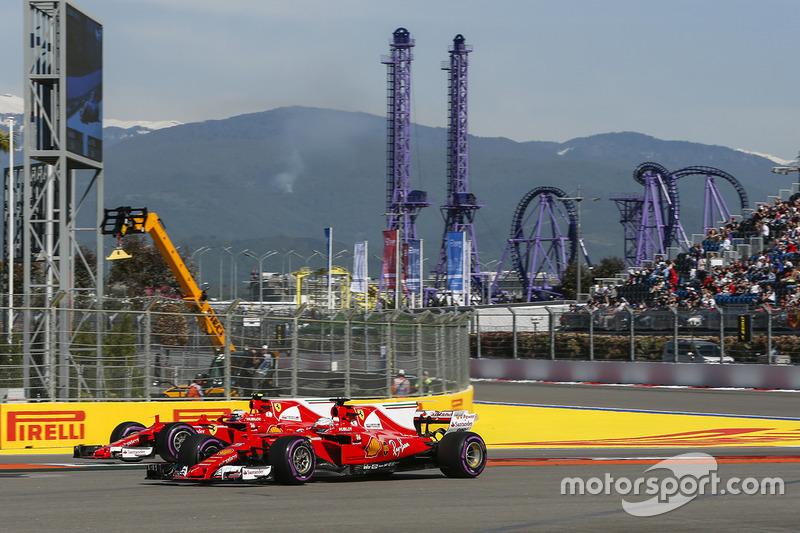 Kimi Raikkonen, Ferrari SF70H and Sebastian Vettel, Ferrari SF70H runs wide