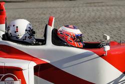 Jenson Button, McLaren, fait une virée avec Naomi Campbell dans la biplace