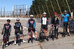 Jamie McMurray, second from right, and friends bike on the closed North Wilkesboro Speedway