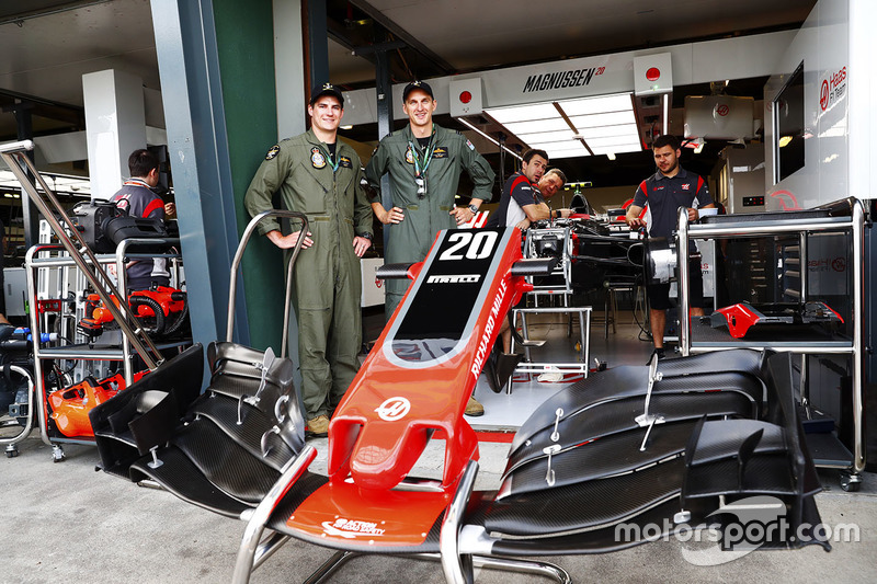 Members of the Royal Australian Air Force outside of the Haas F1 Team garage
