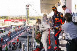 Max Verstappen, Red Bull, second place, Race winner Third place Lewis Hamilton, Mercedes AMG F1 Daniel Ricciardo, Red Bull Racing, spray Champagne on the podium