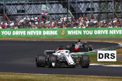Marcus Ericsson, Sauber C37, leads Romain Grosjean, Haas F1 Team VF-18