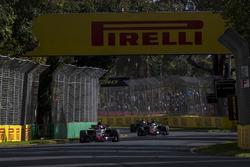 Kevin Magnussen, Haas F1 Team VF-18 Ferrari, leads Romain Grosjean, Haas F1 Team VF-18 Ferrari