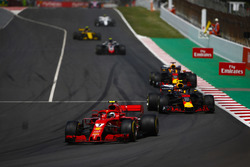 Kimi Raikkonen, Ferrari SF71H, Max Verstappen, Red Bull Racing RB14, and Daniel Ricciardo, Red Bull Racing RB14, behind the safety car