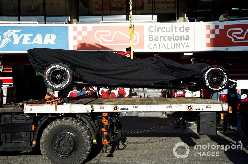 The Kimi Raikkonen Alfa Romeo Racing C38 is returned to the pits