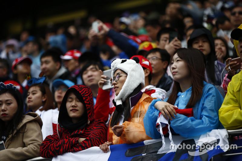 Fan in a Panda hat in the grandstand