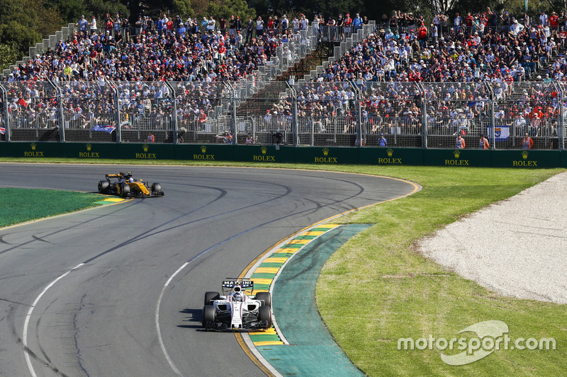Lance Stroll, Williams FW40;  Jolyon Palmer, Renault Sport F1 Team RS17