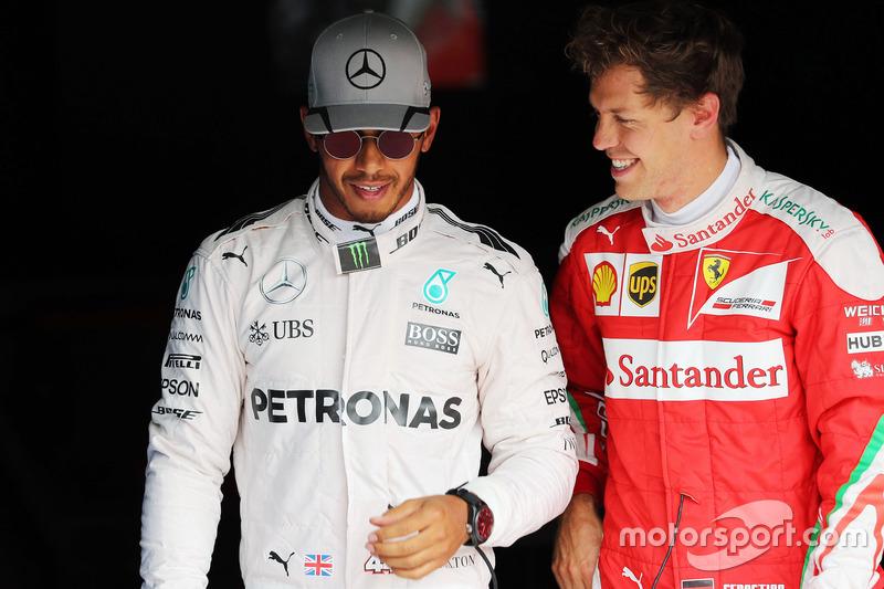 (L to R): Pole sitter Lewis Hamilton, Mercedes AMG F1 with third placed Sebastian Vettel, Ferrari in parc ferme