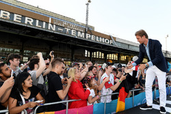 Nico Rosberg, Formula 1 World champion, Formula E investor, signs autographs