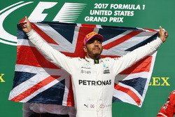Race winner Lewis Hamilton, Mercedes AMG F1 celebrates on the podium with the Union flag