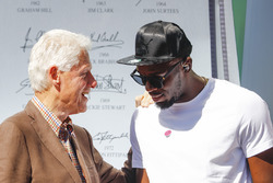 Former US President Bill Clinton and Usain Bolt on the podium