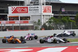 Charles Leclerc, Sauber C37 leads Fernando Alonso, McLaren MCL33