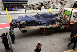 The Red Bull Racing RB13 of Max Verstappen, Red Bull Racing is recovered back to the pits on the bac