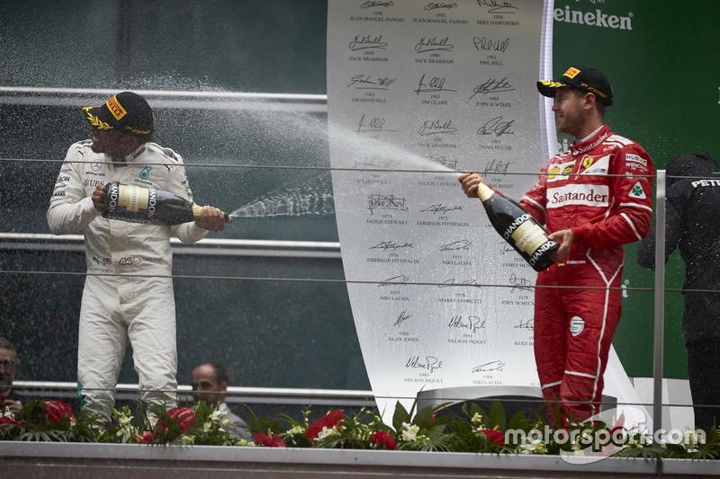 Podium: Lewis Hamilton, Mercedes AMG, and Sebastian Vettel, Ferrari, spray with Champagne on the podium
