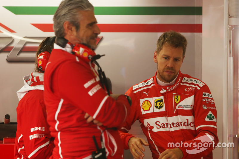 Maurizio Arrivabene, Team Principal, Ferrari, and Sebastian Vettel, Ferrari